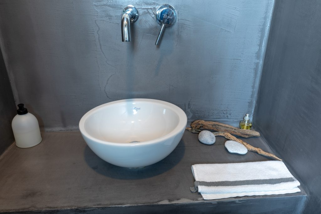 Pressed concrete walls in bathroom and toilet